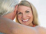 Woman embracing man portrait close up (thumbnail)