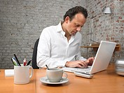 Businessman working on laptop ,