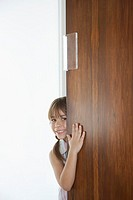 Girl 5_6 peeking from behind door
