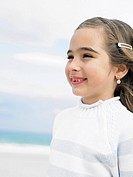Girl 6-8 on beach smiling, close-up