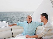 Young and middle_aged man talking on yacht