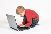 Boy child working on laptop computer, Studio, Oetwil am See, Zuerich, Switzerland