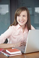 Young businesswoman with laptop computer (thumbnail)