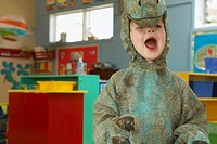 Preschool boy in dinosaur costume