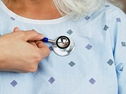 Stethoscope over patient's heart (thumbnail)