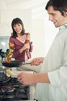 Couple making dinner