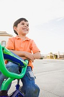 Young boy on a bike (thumbnail)