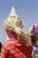 Back of Head of Girl with Party Hat