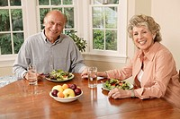Man and woman eating salad