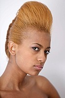 A woman with a quiff hairstyle poses for the camera