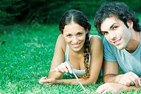 Couple lying in grass together