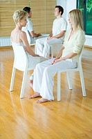 Group therapy, two pairs of adults sitting face to face