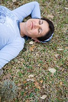 Sleeping woman in grass