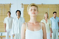 Group meditation, adults standing with eyes closed