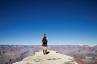 USA, Arizona, Grand Canyon, woman looking out over canyon, rear view