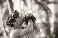 Hawaii, Oahu, Hawaiian man blowing conch shell black and white photograph