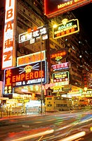 Hong Kong, Kowloon, famous neon lights, streets blurred