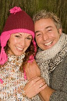Couple wearing knit clothing