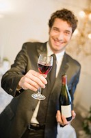 Man offering glass of wine