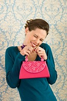 Grinning woman holding purse