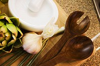 Cutting Board with Vegetables and Wooden Spoons