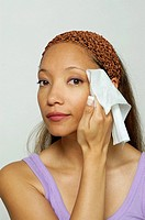 Woman with facial tissue