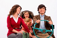 Studio portrait of happy family in imaginary car