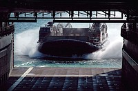 Sasebo Harbor (Sept. 23, 2006) - A Landing Craft, Air Cushion (LCAC) from Assault Craft Unit 5, Detachment Western Pacific makes its way into the well...