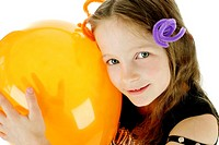 Girl hugging an orange balloon