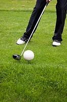 Man trying to hit golf ball with golf club