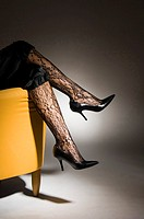 Sexy legs in black lacy stockings and stilettos