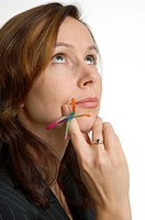 Businesswoman with knot on finger in deep thought