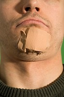 Man with bandage on his chin