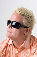Man with sunglasses and earring
