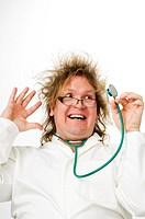 Crazy doctor smiling while looking at stethoscope