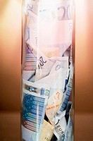 Banknotes in a jar, close up