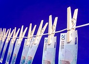 Banknotes hanging on a clothesline