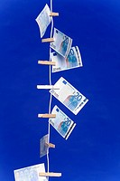 Banknotes hanging on a clothesline, vertical