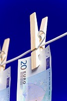 Banknotes hanging on a clothesline, close up
