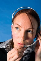 Telephone operator talking on a telephone headset