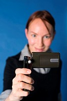 Woman taking a picture with her mobile