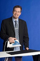 Businessman ironing his pants