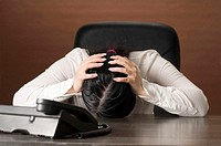 Frustrated businesswoman waiting for telephone call