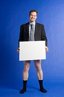 Businessman posing without pants holding a censor sheet