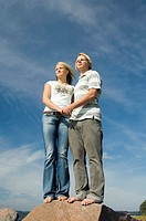 Couple holding hands while looking into the distance (thumbnail)