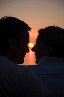 Closeup of couple and sunset