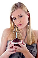 Woman looking sadly at her birthday cake