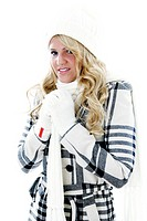 Woman in winter clothing shivering cold