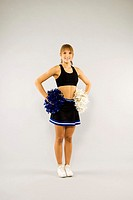 Teenage girl in cheerleading outfit