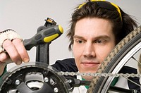 Man repairing his bicycle (thumbnail)